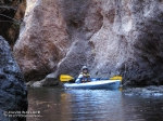 Laura kayaks into Blue Tank Canyon from the Salt River.