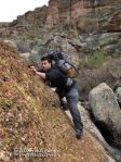 Eric traverses a canyon wall in upper Hells Hip Pocket.
