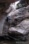 Eric rappels into the short but real nice section of technical canyon in Hells Hip Pocket.