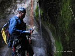 David gets off rope at the end of a rappel down trickling flow.
