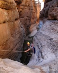 Eric on rappel into the limestone slot of Shinumo Wash.