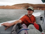 Eric takes in the scenery on our chartered boat ride across Lake Powell to Halls Creek.