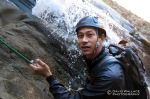Mike on rappel at the mid- rappel station on the multi-pitch of the 400- foot waterfall.