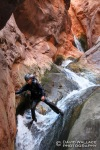 Mike down climbs through the beautiful lower section of the canyon.