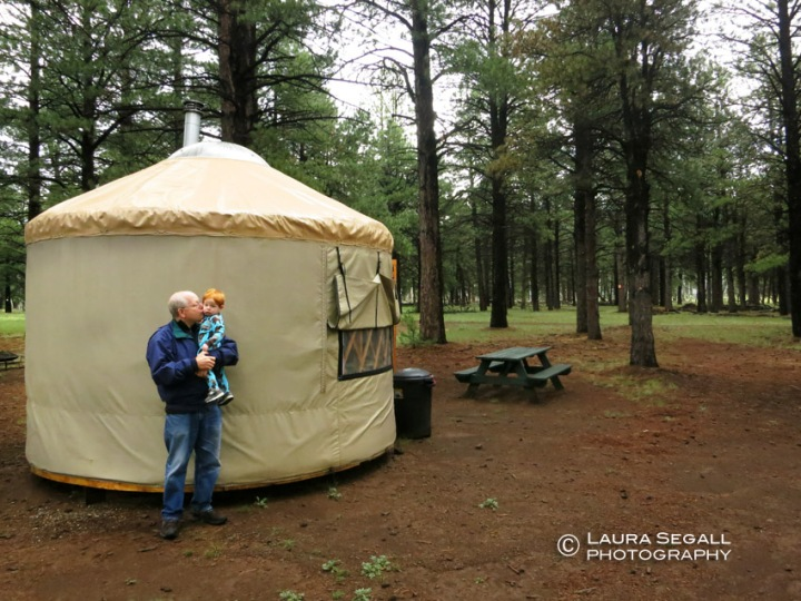 Wyatt and Gramps in front of their yurt at the Nordic Center.