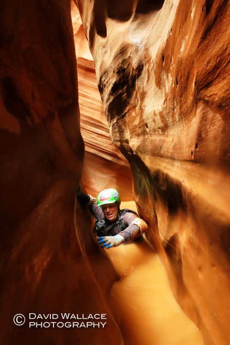 Brian working through chest deep water in sideways shuffling narrows.