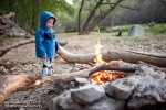Wyatt gets warm by the campfire.