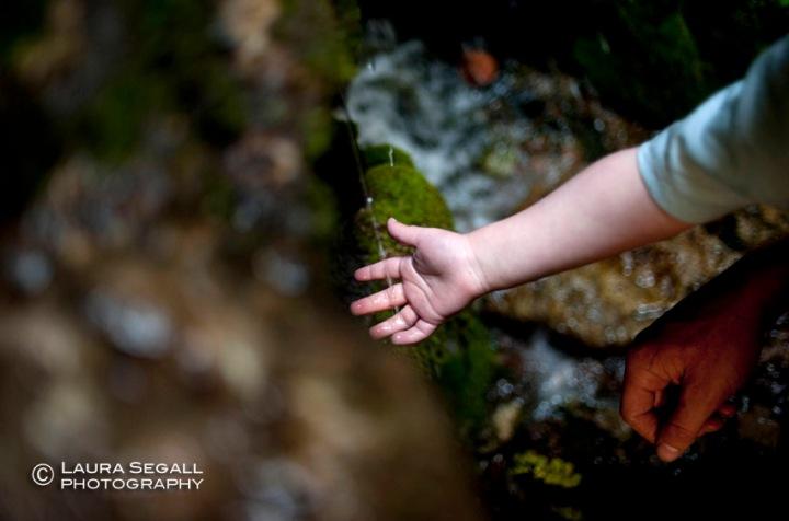 Wyatt feels the dripping water of a spring in Deer Creek.
