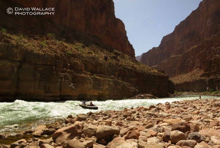 A rafter tackles Upset Rapid in the Colorado River.