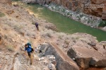 Cody and Eric use a bighorn trail above the Colorado River.