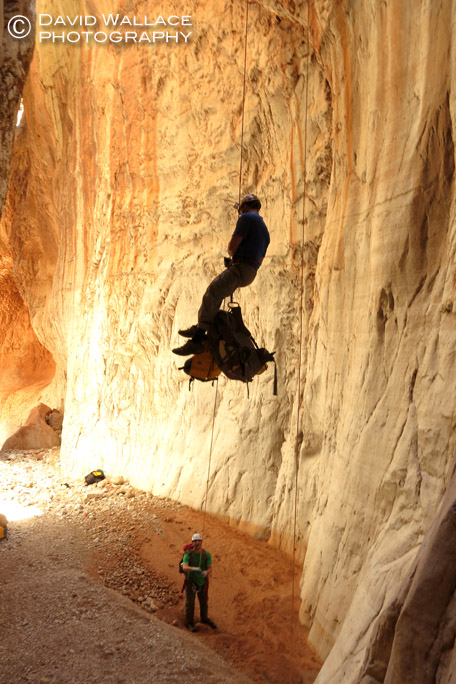Eric raps down the 100- foot drop into the Redwall narrows into Olo Canyon.
