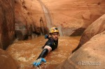 Eric wades in Hard Day Harvey in Glen Canyon National Recreation Area.