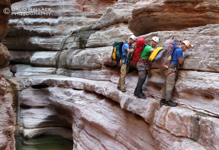 Eric, Mark and Cody traverse a ledge in the Temple Butte narrows in Olo Canyon.
