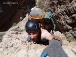 David free climbs out of the Redwall in 150-Mile Canyon.
