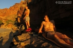 Mark and Cody soak in the last of the sun after a 13- hour day in camp at the head of Panameta Canyon.