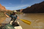 David paddles while canoeing the Green River in Labyrinth Canyon.