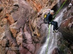 Brian rappels in Big Kahuna Canyon in the Mazatzal Mountains.
