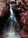 Chris rappels in Big Kahuna Canyon.