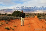 Mike hikes towards Constrychnine in the Poison Springs complex with the Henry Mountains in the background.