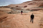 Mike (front) and Eric hike up the sandstone on inclement weather to the head of Sandthrax Canyon.