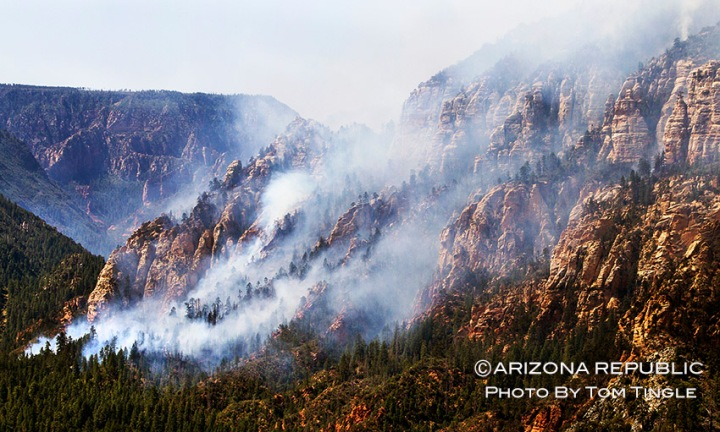 The Slide Fire burns near 89A in Oak Creek Canyon on Wednesday morning, May 21, 2014. (Photo by Tom Tingle/ The Arizona Republic)