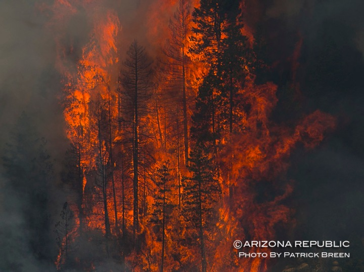 Flames and smoke rise from the Slide Fire in Oak Creek Canyon on May 23, 2014. (Photo by Patrick Breen/ The Arizona Republic)