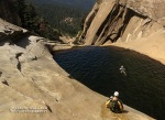 Mark control slides down a granite face into a large pool.