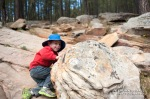 Wyatt climbs up on some rocks near Willow Springs Lake.