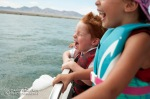 Wyatt and Aisha while cruising at high speed on a pontoon boat on Lake Havasu.
