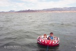 Wyatt and Dylan tubing on Lake Havasu.