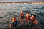 Aisha, Farrah, Wyatt and David swimming in the warm waters of Lake Havasu during sunset.