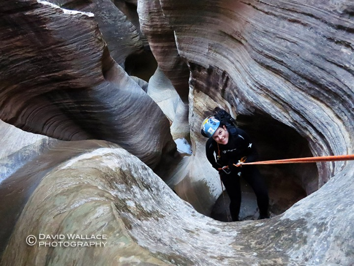 Laura rappels in the narrows.