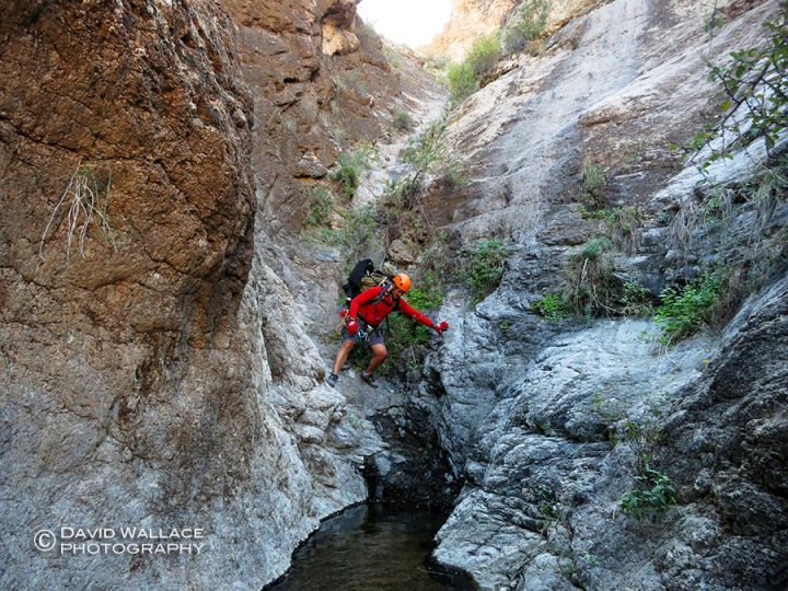 Chris moves through the short narrows of Pick Axe Canyon.