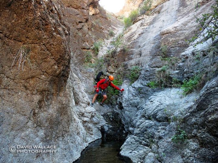 Chris moves through the short narrows of Pick Axe Canyon.