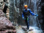 Chris getting hit with super cold water after getting off rappel.