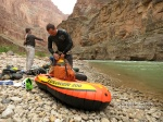 At the mouth of Tuckup Canyon, Mark and Brian prepare their pack rafts for a float down the Colorado River to National Canyon.
