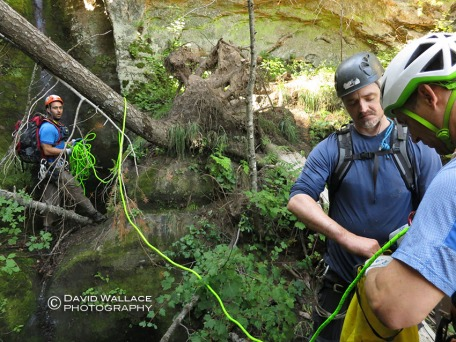 Eric, Kyle and Mark work on bagging rope after the first drop.