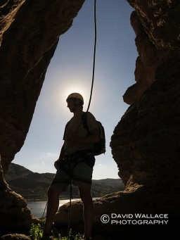 Seth silhouetted after a rappel.