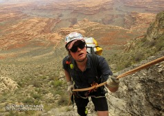 Unable to find a break in the cliffs, Chris rappels to get past the Coconino layer.