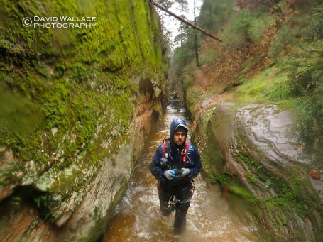 Eric making his way through wet narrows in Behunin Canyon.