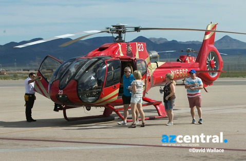 Passengers get off a Papillon Grand Canyon Helicopter after flying to the western part of Grand Canyon National Park, at the airport in Boulder City, Nevada, on March 21, 2017. 300-400 helicopters fly per day over the western part of Grand Canyon National Park.